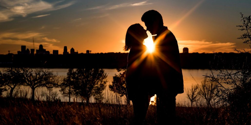 Sunset Couple Silhouette kissing with skyline